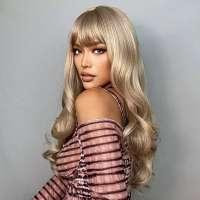 Pruik lang blond krullend haar met pony model 229