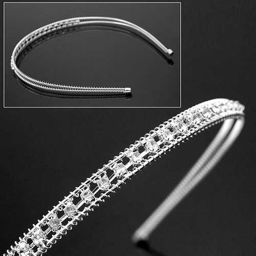Zilverkleurige haarband / diadeem met glinster steentjes